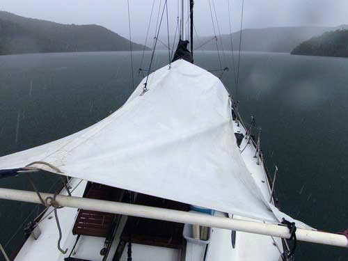 Awning and rain catcher for cruising yachts